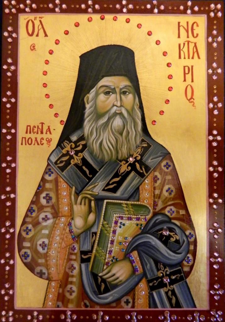 Sfantul Ierarh Nectarie de la Eghina- Icoana realizata pe lemn, in tehnica bizantina, cu foita de aur de 23,7k, si aplicatii de pietre semipretioase. Dimensiune A4