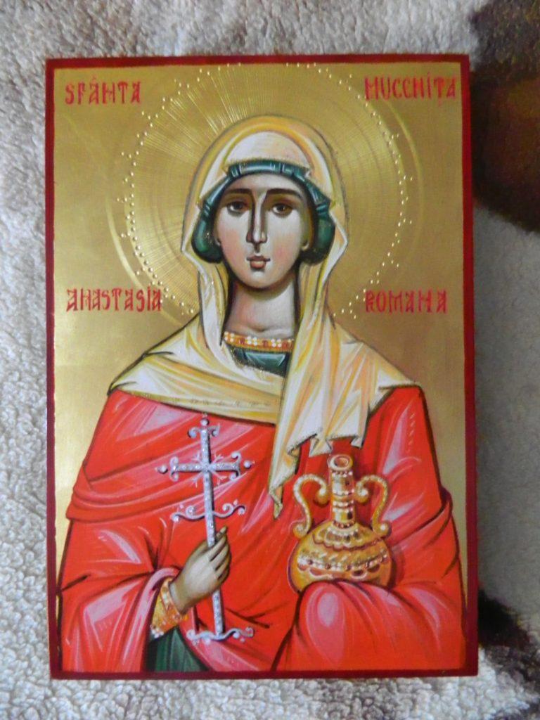Sfanta Mucenita Anastasia Romanai Icoana pictata pe lemn, in stil bizantin cu foita de aur de 22k, tempera cu emulsie de ou. Dimensiune A4